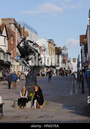 The Surrey Scholar Statue and Guildford High Street - Stock Photo