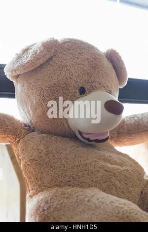 Smiling big bear doll toy beside window stock photo 115816455 alamy smiling big bear doll toy beside window stock photo publicscrutiny Choice Image