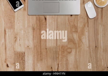 laptop, smartphone, mouse, coffee cup on wooden desk - top view ...