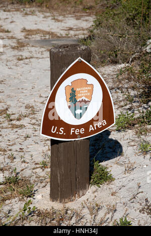 US fee area sign mounted on a wooden post at a camping site in Fort Pickens Pensacola Florida USA - Stock Photo