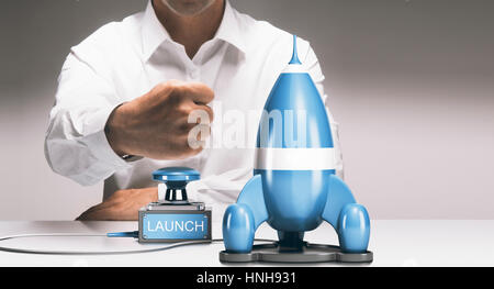 Man about to launch a rocketship. Advertising concept of company startup or business boost. Composite between a - Stock Photo