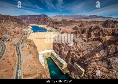 Aerial wide angle view of famous Hoover Dam, a major tourist attraction located on the border between the states - Stock Photo