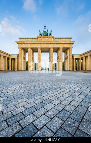 Classic vertical view of famous Brandenburg Gate, a national symbol of Germany, in beautiful golden morning light - Stock Photo