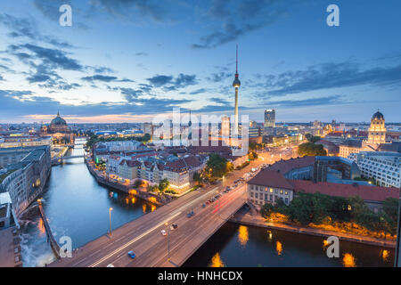 Classic aerial view of Berlin skyline with famous TV tower and Spree river in beautiful post sunset twilight during - Stock Photo