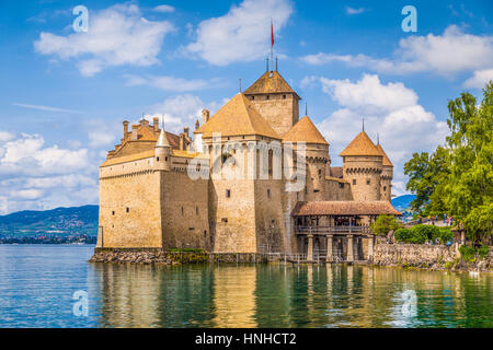 Classic view of famous Chateau de Chillon at beautiful Lake Geneva, one of Switzerland's major tourist attractions - Stock Photo