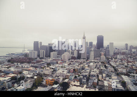 Classic panoramic view of San Francisco skyline in summer with famous San Francisco fog rolling in seen from historic - Stock Photo