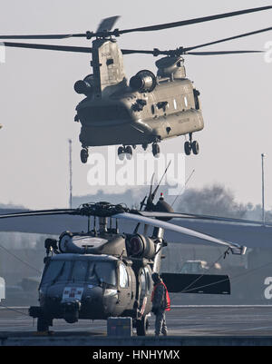 Bremerhaven, Germany. 14th Feb, 2017. A US 'Chinook' helicopter takes off for operation 'Atlantic Resolve' from - Stock Photo