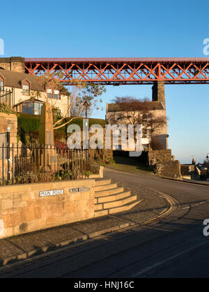 The Forth Bridge Looms over the Main Street at North Queensferry Fife Scotland - Stock Photo