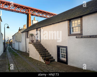 The Forth Bridge Looms Over a Quiet Lane at North Queensferry Fife Scotland - Stock Photo