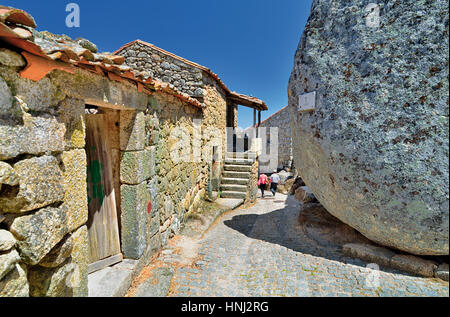 Portugal: Small alley passing granite stone houses and huge rocks in Monsanto - Stock Photo