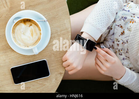 Cup of coffee, watch and mobile phone - Stock Photo