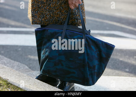 Man with blue camouflage bag before Emporio Armani fashion show, Milan Fashion Week street style on January 14, - Stock Photo