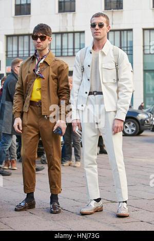 Two elegant men before Salvatore Ferragamo fashion show, Milan Fashion Week street style on January 15, 2017 in - Stock Photo
