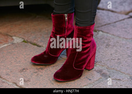 033b9011beb Woman with red velvet low boots before Salvatore Ferragamo fashion show