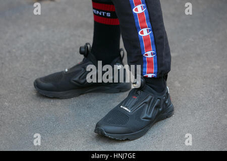 Man with black Reebok Vetements shoes before N 21 fashion show, Milan Fashion Week street style on January 16, 2017 - Stock Photo