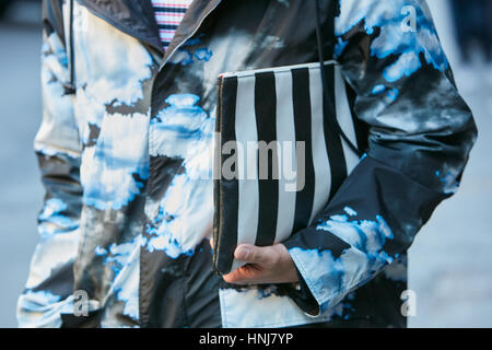 Man with striped black and white bag before MSGM fashion show, Milan Fashion Week street style on January 16, 2017 - Stock Photo