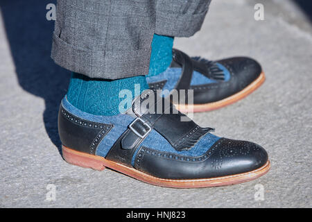 Man with black and blue shoes before Giorgio Armani fashion show, Milan Fashion Week street style on January 17, - Stock Photo