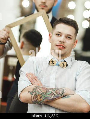 hand holding mirror tattoo. Beautiful Mirror Barber Holding A Mirror For Client  Stock Photo Inside Hand Holding Mirror Tattoo