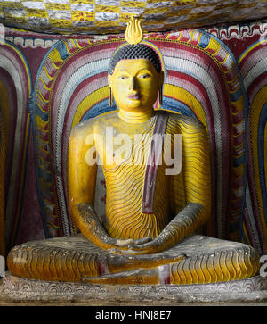 Insides of caves in ancient Buddhist complex in Dambulla cave temple. Sri Lanka. The photograph is presenting the - Stock Photo