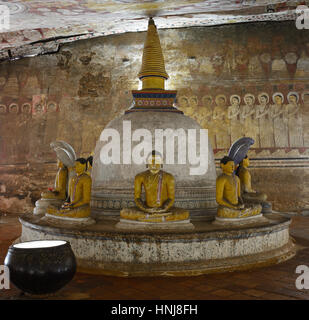 Insides of caves in ancient Buddhist complex in Dambulla cave temple. Sri Lanka. - Stock Photo