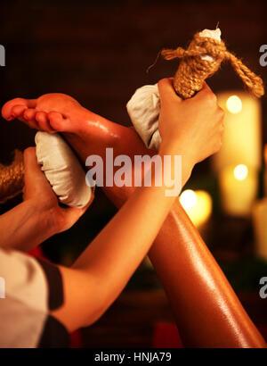 Feet massage with Thai reflexology. Cropped shot of foot reflexology. - Stock Photo