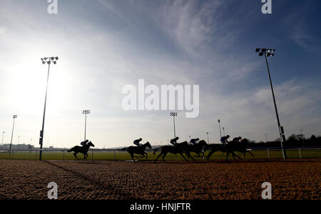 Runners and Riders are silhouetted as they round the first bend during The 32Red Casino Maiden FilliesÂ' Stakes - Stock Photo