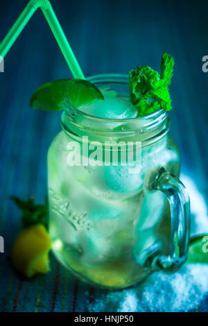 Refreshing Citrus Iced Green Tea with a Straw - Stock Photo