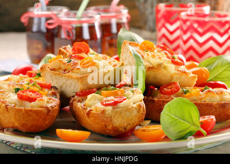 Fresh healthy vegetarian sandwich with cheese and tomato - Stock Photo