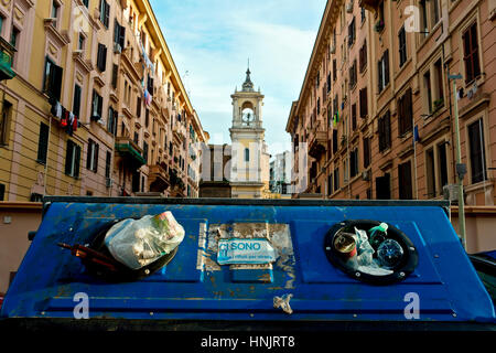 Rubbish. Trash can full of garbage in front of condominium buildings. Rome, Italy, Europe - Stock Photo