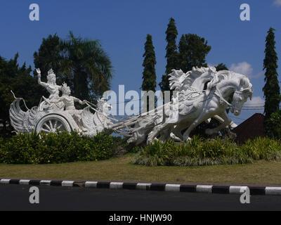 Arjuna and Krishna hindu gods riding chariot statue in Bali, Indonesia - Stock Photo