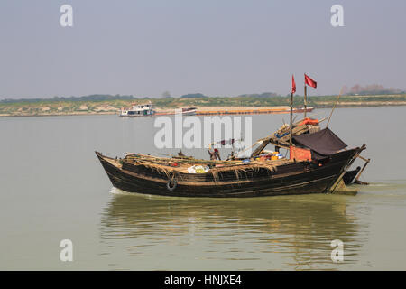barge with wood on the irrawaddy river near mandalay myanmar stock