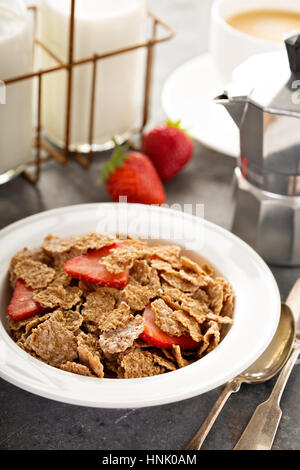 Multigrain wholewheat healthy cereals with fresh strawberryfor breakfast - Stock Photo