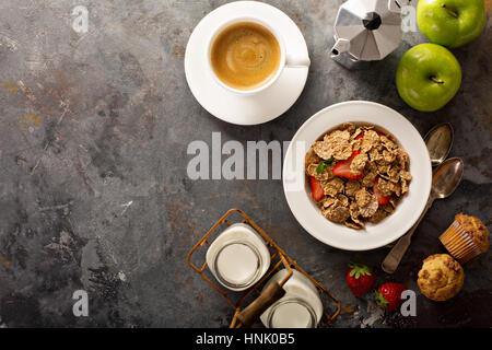 Multigrain wholewheat healthy cereals with fresh strawberryfor breakfast with copyspace overhead shot - Stock Photo