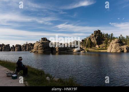 Man fishing at Sylvan Lake. Sept, 2016. Custer State Park, South Dakota, USA - Stock Photo