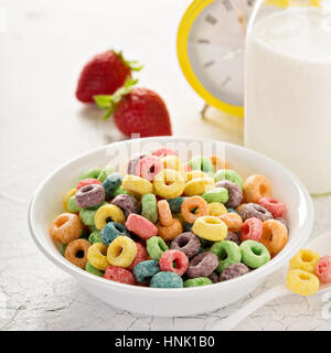 Fruit colorful sweet cereals in a bowl, traditional quick breakfast or snack for kids - Stock Photo