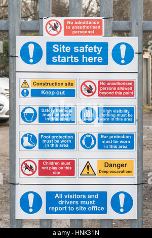 UK construction / building site health and safety warning sign pinned to metal fencing, building site fence. Construction - Stock Photo