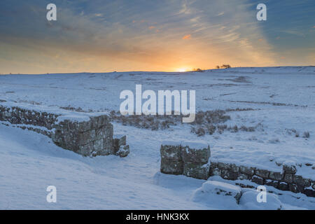 Hadrian's Wall: the south gate of Milecastle 42 at Cawfield at dawn on a cold, snowy winter's morning - Stock Photo