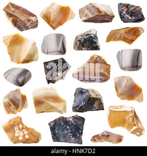 collection of tumbled and raw flint mineral stones isolated on white background - Stock Photo