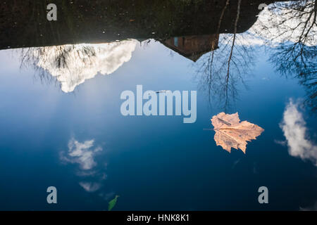 Reflection on calm water at Birmingham Canal - Stock Photo