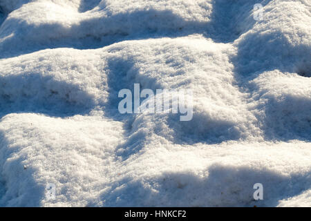 Snow with traces of car - Stock Photo