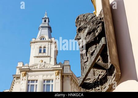 The bronze bust of Franz Kafka on the native house, Prague, Czech Republic - Stock Photo