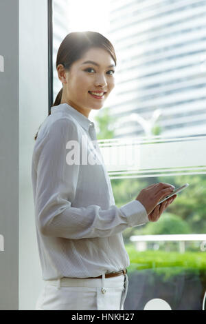 Business women use tablet PCs - Stock Photo