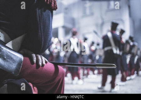 a lot of rifles/muskets leaning at a house wall with a window in Paris - Stock Photo