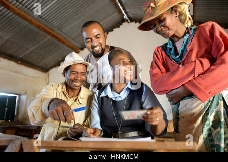 Villagers fill out applications for certification of their land on the village square, Analakely village, Tanambao - Stock Photo
