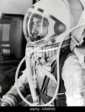 Astronaut Alan Shepard in his silver pressure suit with the helmet visor closed as he prepares for his upcoming - Stock Photo