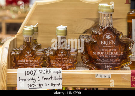 TORONTO, CANADA - DECEMBER 21, 2016: Maple Syrup for sale on St Lawrence Market in Toronto, Ontario, Canada - Stock Photo