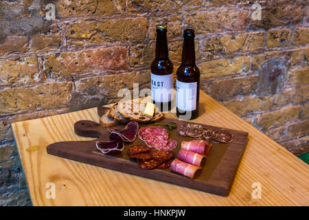 Charcuterie platter with craft beer. - Stock Photo
