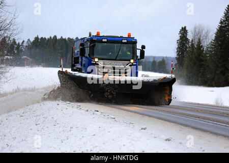 SALO, FINLAND - JANUARY 14: Scania truck equipped with snowplow removes snow and sleet from highway in South of - Stock Photo