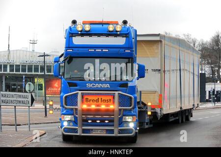 HELSINKI, FINLAND - JANUARY 16, 2017: Blue Scania semi wide load oversize transport of prefabricated house module - Stock Photo