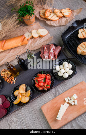 Bruschetta Ingredients for preparation with board and knife. Italian food. - Stock Photo